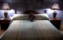 Victoria Crown Plaza Hotel Deluxe Suite Bedroom