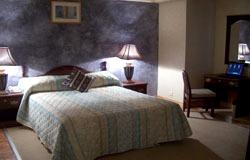 Victoria Crown Plaza Hotel Executive Suite Bedroom